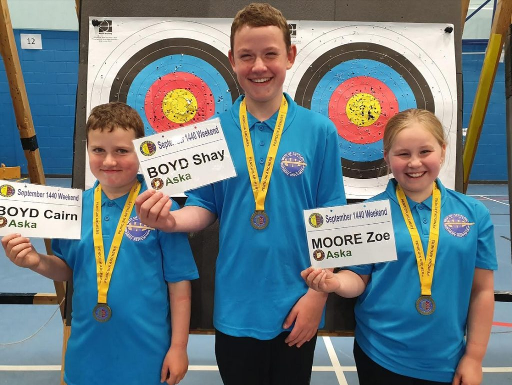 Cairn Boyd, Shay Boyd & Zoe Moore holding up the gold medals they won for winning their classes in the Penicuik 1440 shoot on the 8th September.